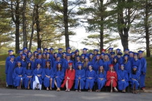 Group of dual enrollment graduates in their caps and gowns
