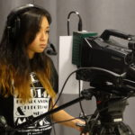 Media Arts & Technology - Video Student Using a Camera
