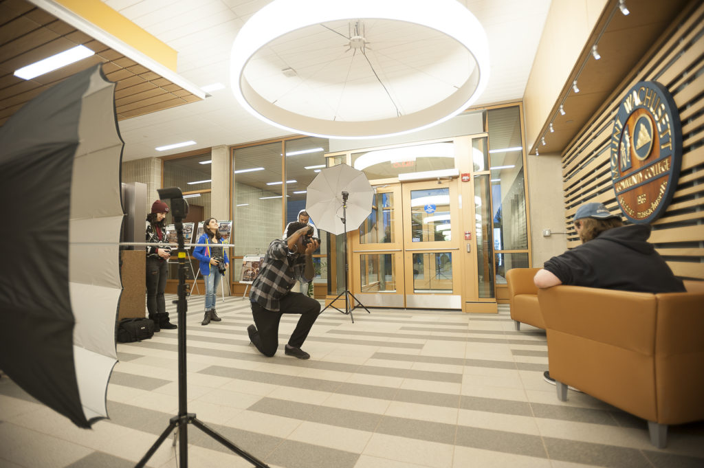 Media Arts & Technology - Photography Students Taking Photos of Subject in the Hallway