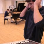 Media Arts & Technology - Audio Student Listening to Piano Recording