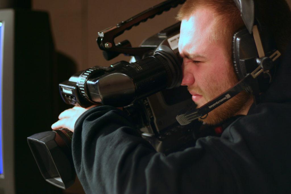 Media Arts & Technology - Video Student using a Camera