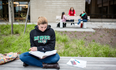 Female student studying outside campus