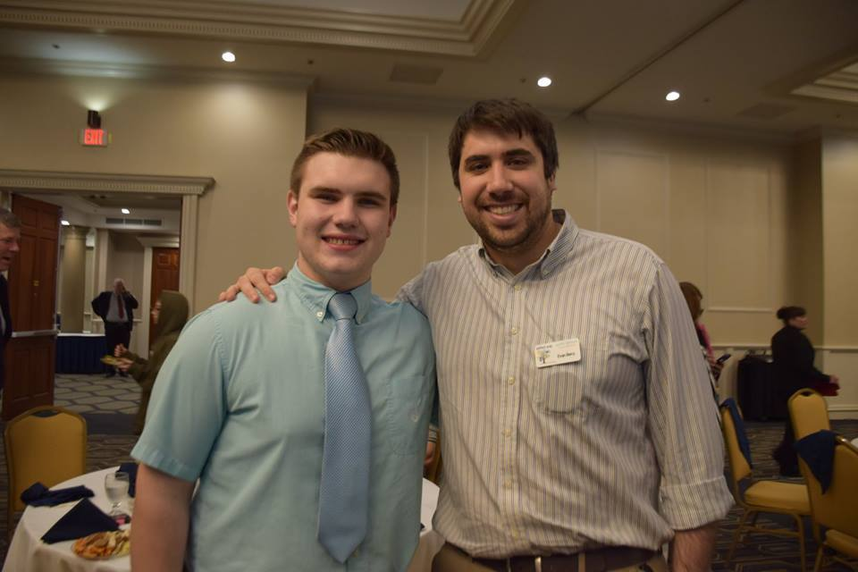 Aidan Provost and program director Evan Berry at an event