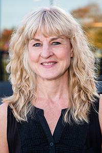 Headshot of Janine Eisner-Wall