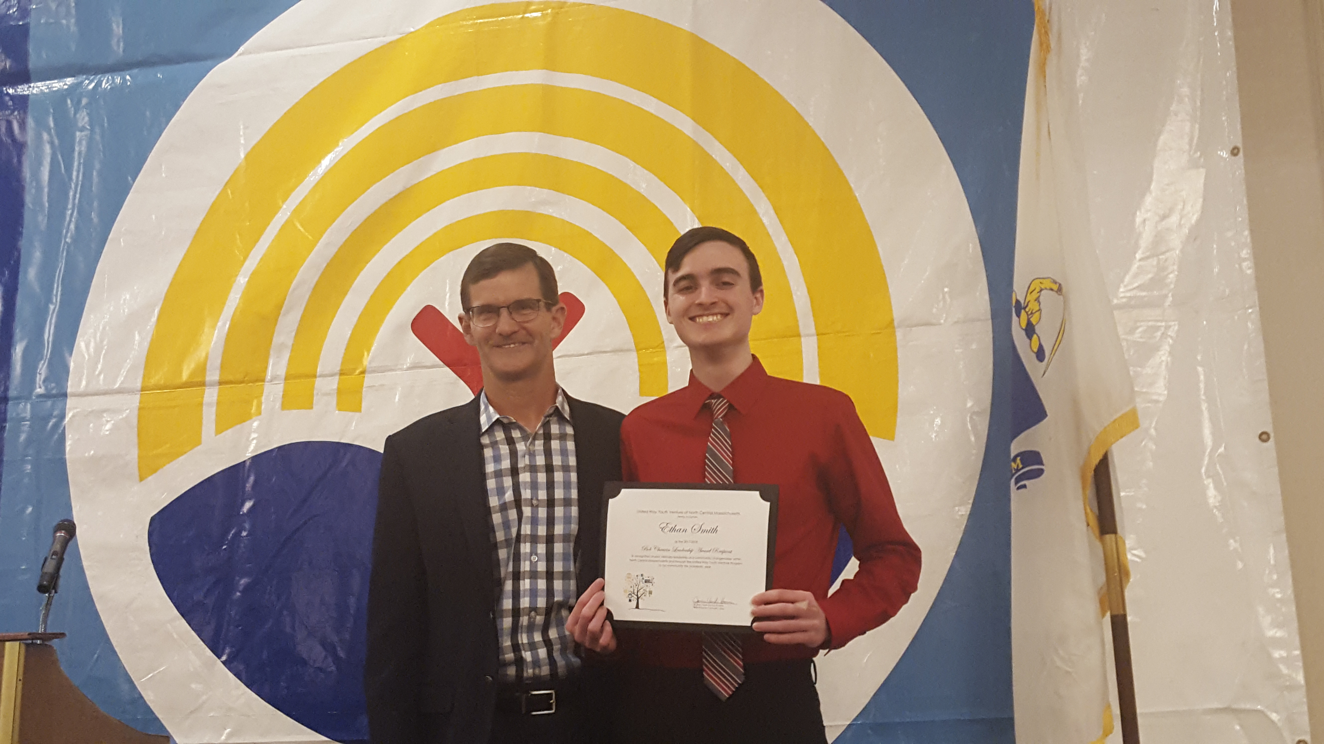 Ethan Smith with his scholarship certificate, with Bob Chauvin