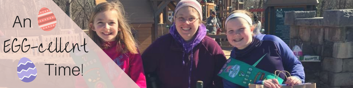 Three girl scouts standing at their life buckets table during their Easter egg hunt fundraiser