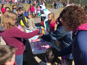 Life Buckets Venture Team selling first aid kits at their table during their Easter egg hunt fundraiser