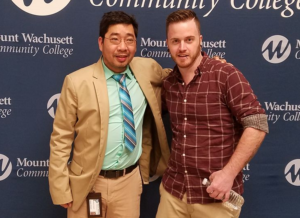 Professor Sunny Nguyen with Peter in front of the MWCC background