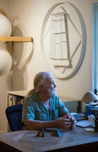 Artist, Robert G. Osbourne, at his desk