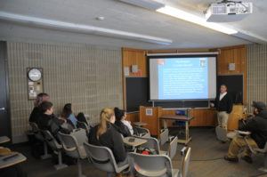 Photo of Professor Bigelow giving slide presentation to Introduction to Criminal Justice class