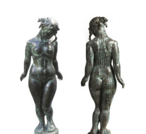 A bronze sculpture is pictured front and back.