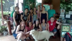 MWCC students and staff pose for picture with dog at Monkey Sanctuary in Costa Rica