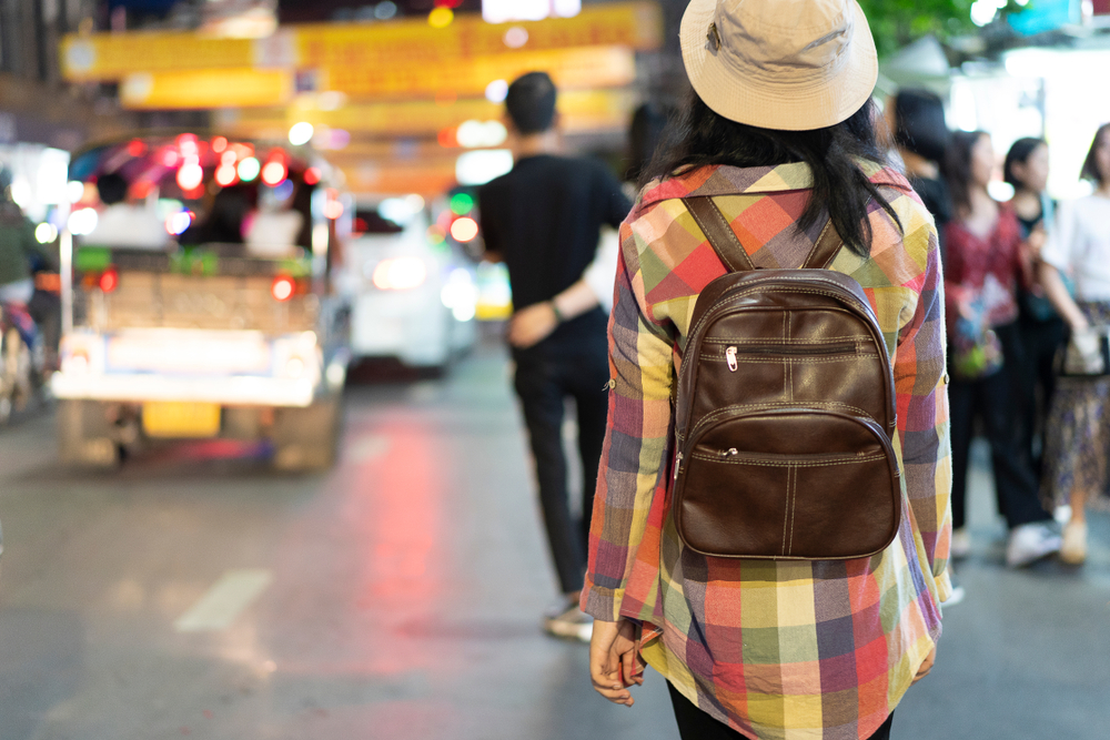 study abroad student with backpack