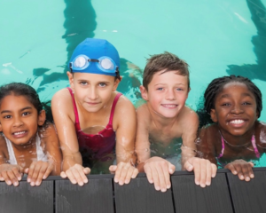 photo of kids swimming in a pool