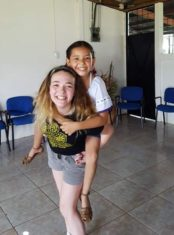 Photo of Araya with school child in Costa Rica