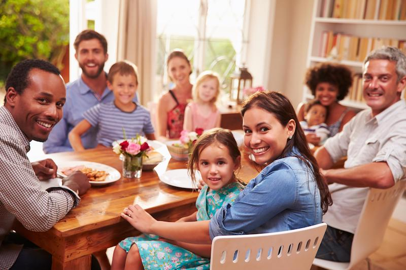 a family sits around a table