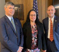 Robert Antonioni, Irene Hernandez, Jim Vander Hooven standing together in front of american flag