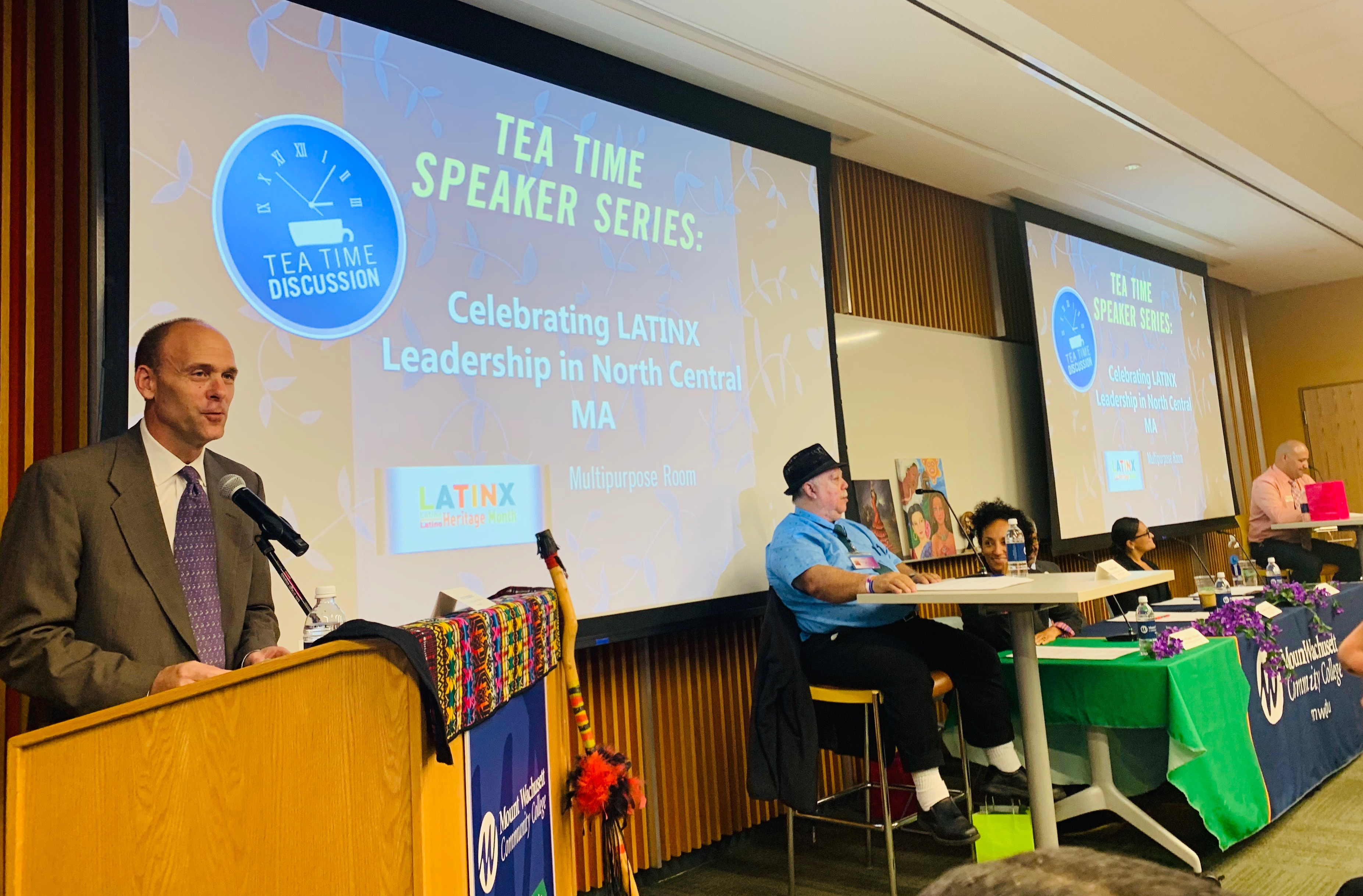 President James Vander Hooven welcomes a panel of Latinx leaders to a Tea Time Speaker Series event at Mount Wachusett Community College.