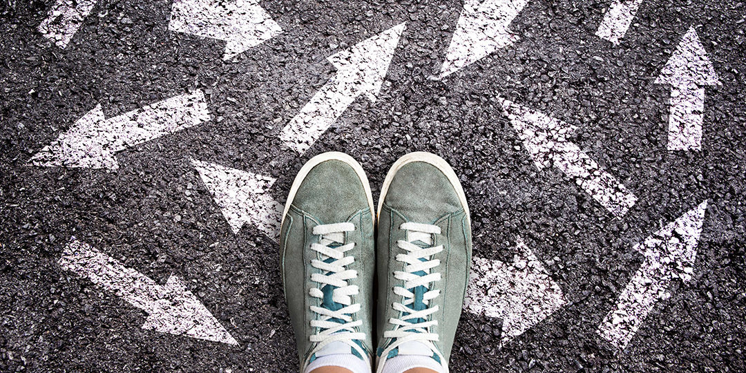 pair of feet with arrows going different directions blog image