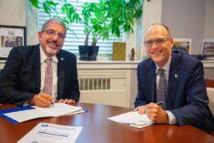 QCC President Luis G. Pedraja, Ph.D. and MWCC President James L. Vander Hooven, Ed.D.