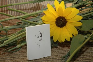 Sunflower with photo of a drawn photo of Carrie Progren