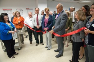 Group cutting the red ribbon in the Devens campus