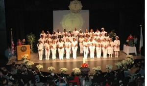 Formal group shot of practical nursing group in their white uniforms