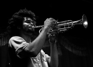 Black and white photo of Peter Shungu playing the trumpet
