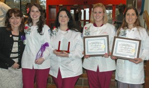 A group of dental students in their uniforms