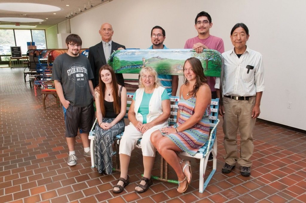 Group of art students with their painted ski chairs with Art Department profesor Tom Matsuda and President Dan Asquino
