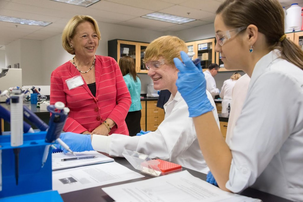 Congresswoman Niki Tsongas speaks with Mount Wachusett Community College biotechnology students Dana Procell and Savannah Cooke during a tour of the college's Devens campus Monday. The Congresswoman joined state and college officials to celebrate the start of Manufacturing Week.