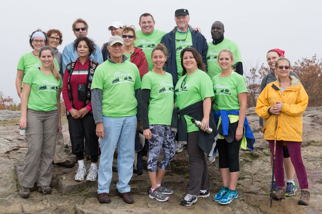 Group of faculty, staff, students and community members at the top of Mount Wachusett