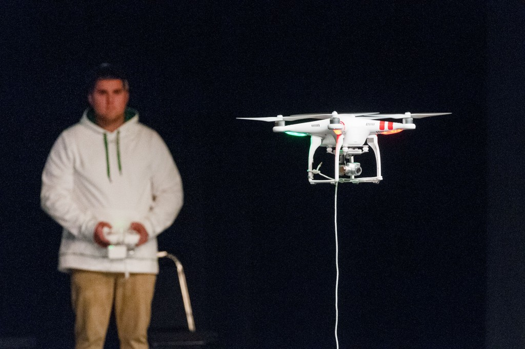 Mount Wachusett Community College pre-engineering student Casey Bortle pilots the college's new drone during a Math Modeling Initiative presentation to 350 area high school seniors.
