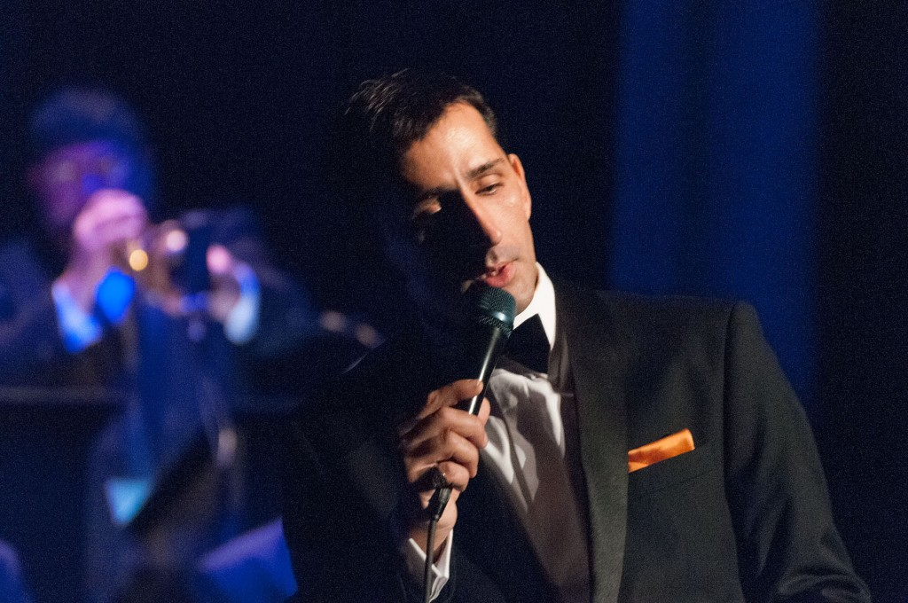 Frank Sinatra stylist Chris Jason singing at the Frank Sinatra event