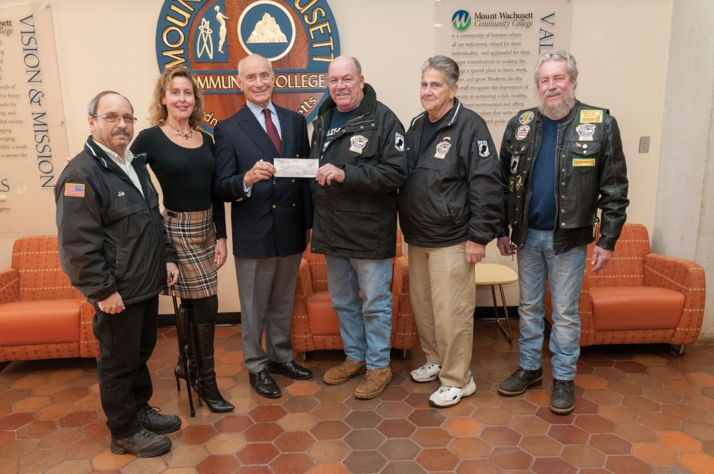 Group of Veterans presenting a check to President Dan Asquino and Carla Zottoli