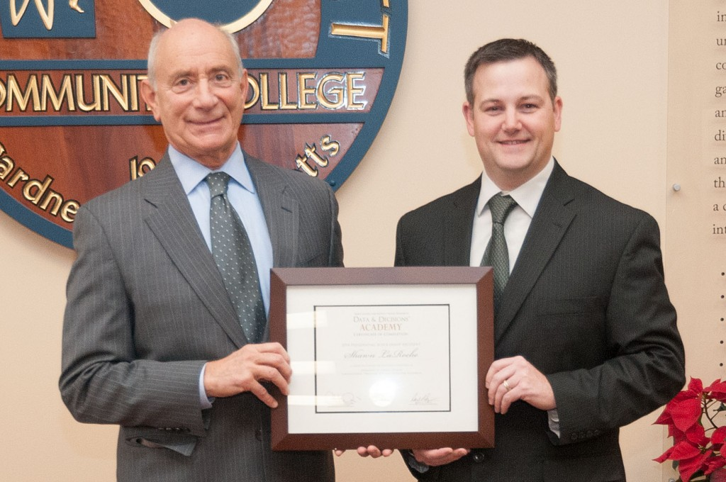 President Dan Asquino and Shawn LaRoche holding his certificate of completion