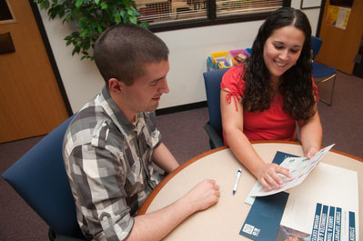 Staff member advising a student