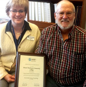 Dean Janice Barney and Auto Tech Department Chair Professor Peter Kaufmann witht he NATEF Accreditation Certificate