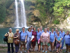 Group photo of nursing students/chaperones in front of a waterfall in Haiti