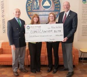 President Asquino, Connie Helstowski, Nancy Thibideau and Phil Grzewinski holding the big COMECC/UWNCM check