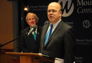 Senator Brewer looks on as Congressman Jim McGovern speaks at the podium