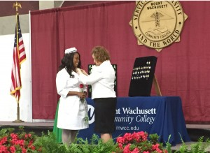 Fortunate Munhutu on stage receiving her pin from Dean Eileen Costello