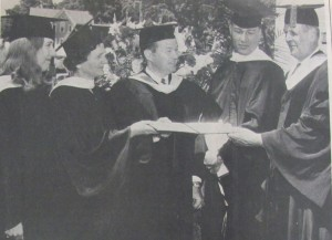 Historical black and white photo of MWCC graduates with President Haley