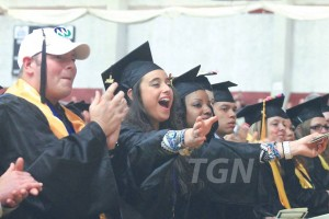 Graduates clapping during the commencement ceremony