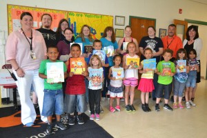 Otaku club presenting book donations to a group of children