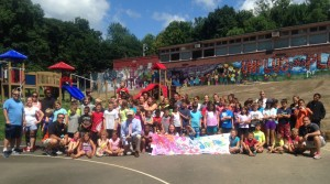 Summer UP participants at Jackson Playground in Gardner presented a thank you banner to President Daniel Asquino and Mayor Mark Hawke for their continued support of the program.