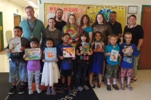Following another successful club fundraiser, the Otaku United club at Mount Wachusett Community College donated more than 1,000 books to Waterford Street School children. Pictured in the back row behind the elementary school students, from left: Waterford Street School Principal Daniel Hill, Heather Chandry (club president);Jonathan Cohen (vice president); Rebekah Cohen (treasurer); Andrea Bartlett (auction coordinator); Cassandra Cohen (secretary); first grade teacher Peter Pianka; and Assistant Principal Melissa McDonald.