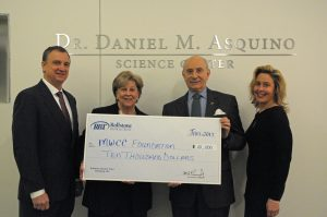 Arthur Feehan and Linda L. Racine presenting a check to President Daniel Asquino and Carla Zottoli