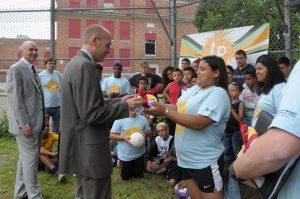 Students giving President Vander Hooven a shirt