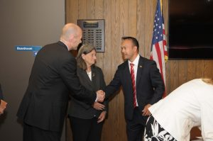 President Vander Hooven shaking Dean Tran's hand